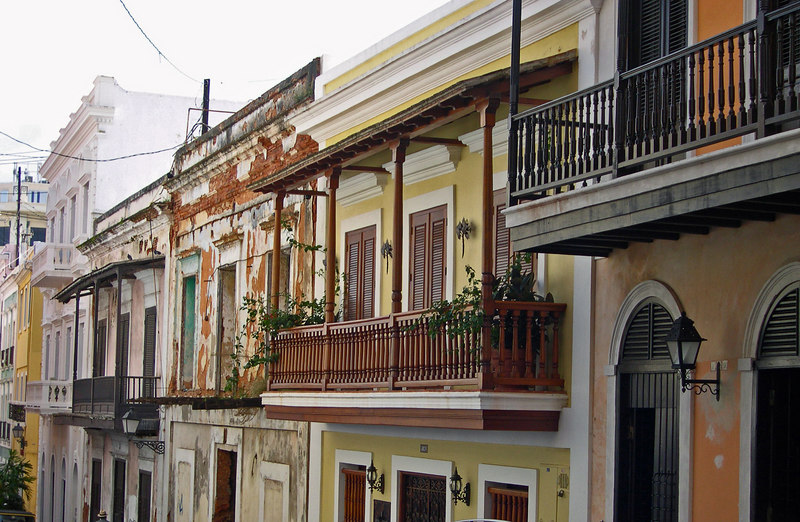Old villa facades stand next to restored Spanish Colonial Buildings in Old San Juan - Puerto Rico
