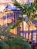 Sunset and Palm trees cast Shadows on old fading building - Bridgetown - Barbados