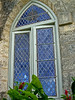 Old caribbean church with lattuce stained windows and tropical foiliage - Holetown - Barbados