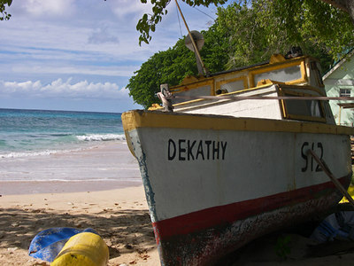 Fishing boat sits on the pink sands next to the Caribbean Sea - Bridgetown - Barbados