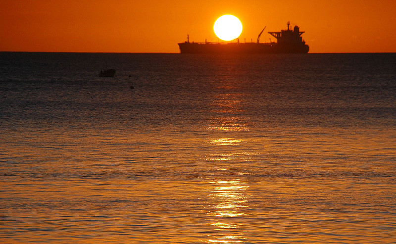 Big sun over big boat. Statia