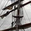 To unfurl the sails, the crew must climb aloft and stand on a rope while bending over the whole structure to loosen the lines holding the sails closed. This must be repeated, along with a lot of hoisting, to take in the sails.