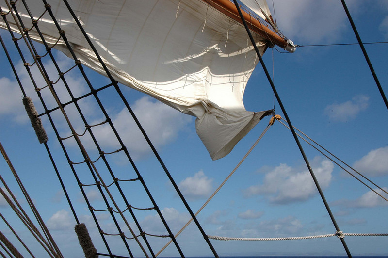 Sail being raised.