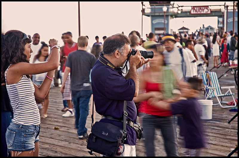 Photographers shooting the sunset, slow shutterspeed.