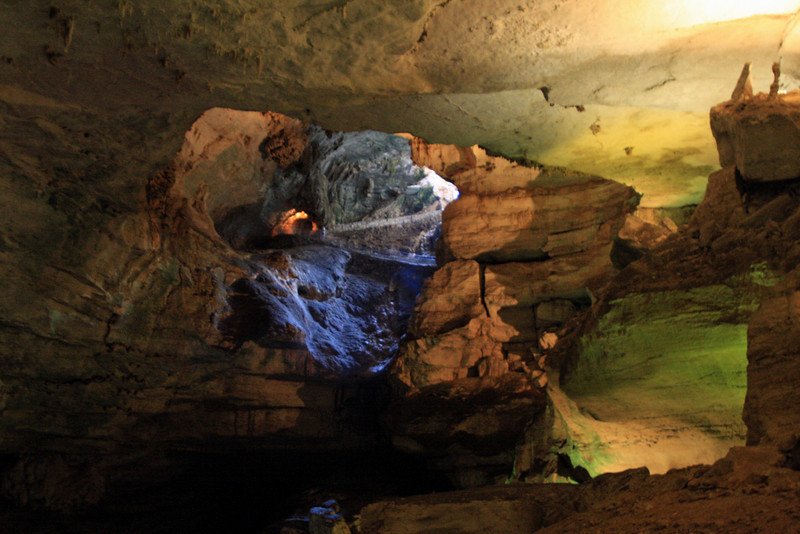This shot is looking back up at the cave's entrance where surface light is filtering down.  The paved switchback path which descends into the cave is visible near the center.