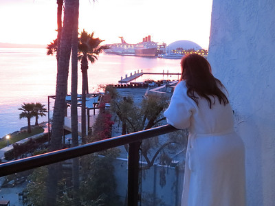 A view from the Hotel Maya at Sunrise, that is my beautiful wife enjoying the view and looking forward to the cruise.