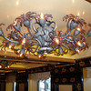 "Carnival's chief architect, Joe Farcus, has created hundreds of chandeliers exclusively for Carnival Legend. While his tendency is to over decorate,these ships exude Carnival's ""Fun Ship"" theme."