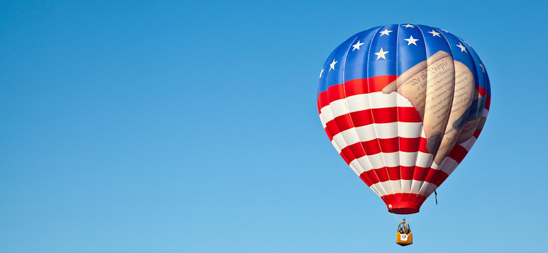 A hot air balloon with a United States Flag and a scrooll reading the preamble of the United State Constitution. Carolina Balloon Festival, Statesville, North Carolina.