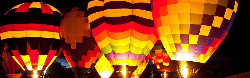 A number of Hot Air Balloons fire their burners lighting up the entire balloon. Carolinas Balloon Festival, Statesville, North Carolina.