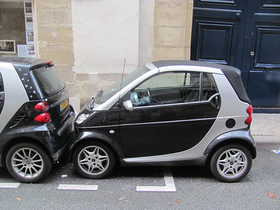 French parking job.  (Smart Cars all over the place).