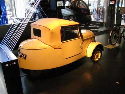 Two rear wheels, sort of like a tractor..