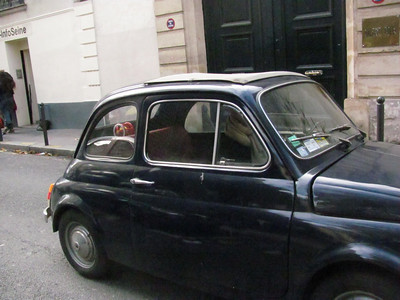 Original Fiat 500L from the 60s or early 70s.  800cc engine with 23 horsepower (less than my 650cc motorcycle), air cooled.  Smaller than a mini cooper.  My favorite care there...