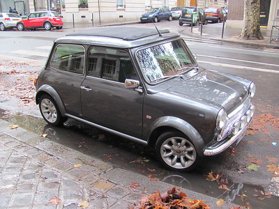 Beautifully-restored French version (left hand drive) of the original mini cooper with a rag top.