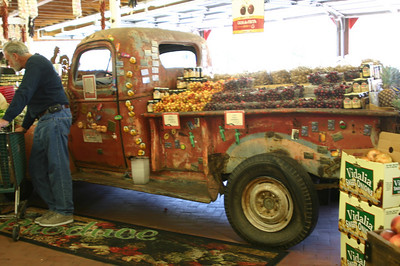 Inside the store--a big old truck loaded with fruit and nuts.  Present company excluded.