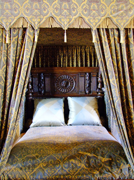 A royal bed chamber.  Those of the royal family had curtains around the sides.
