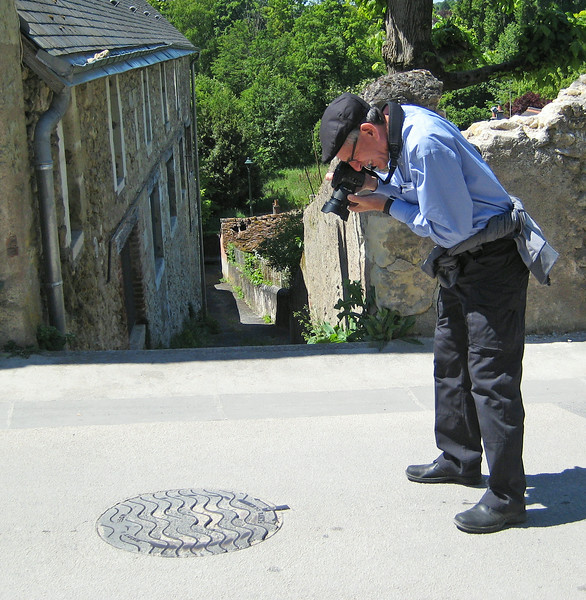Taking yet another manhole cover photo
