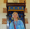 Jan with her tour headset in front of the throne.