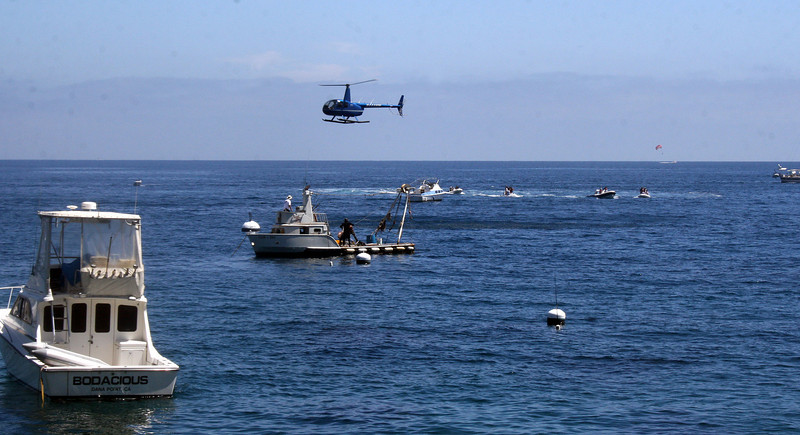 An incident on Tuesday, August 3 in which a helicopter and boats were circling near Descanso Beach. Never found out what was happening.