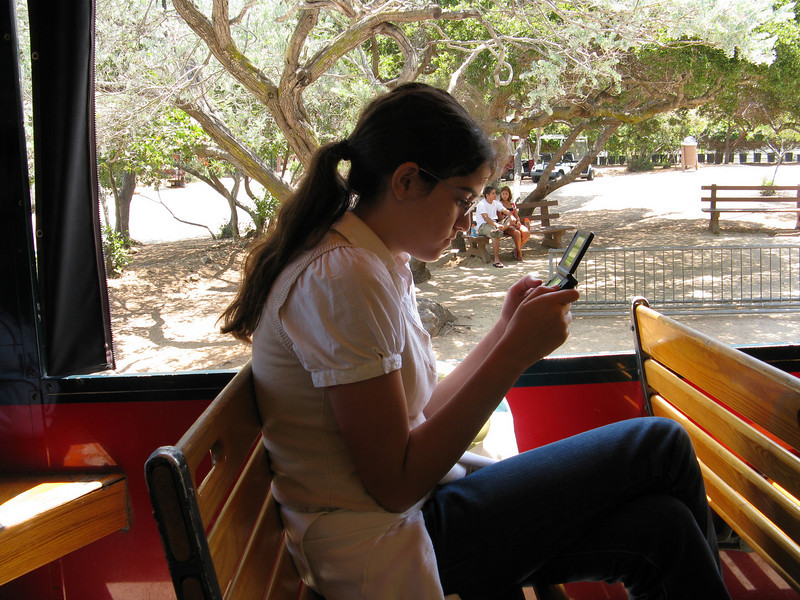 Alicia and her Gameboy on the trolley.