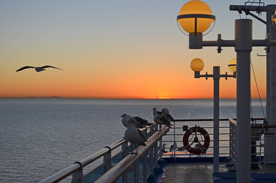 Sunrise over the Mainland from Aft Deck
