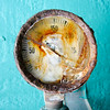 Very rusty gauge on the pleasure pier, which is painted a great aqua color.