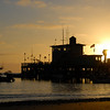 """Sunrise over the pleasure pier. I'm not sure why they call it the """"pleasure pier"""" instead of just """"pier"""", but that's what we kept hearing."""