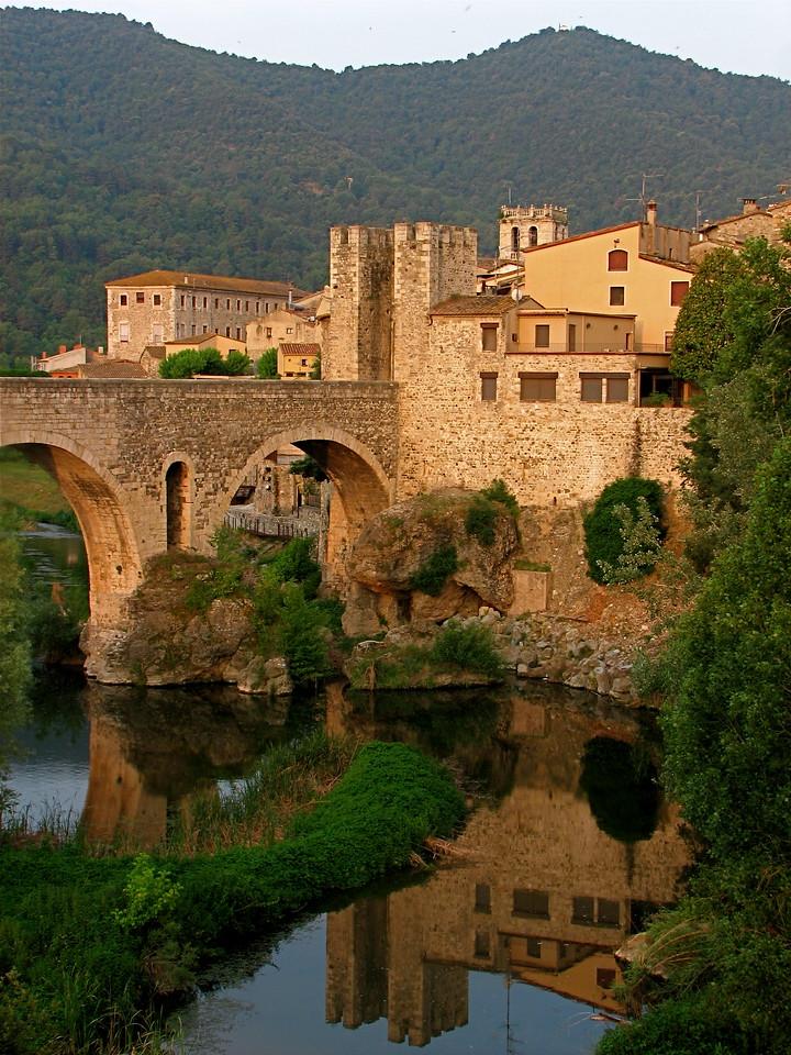12th century gated Medieval bridge over the Rio Fluvia, Besalu, Catalonia, Spain