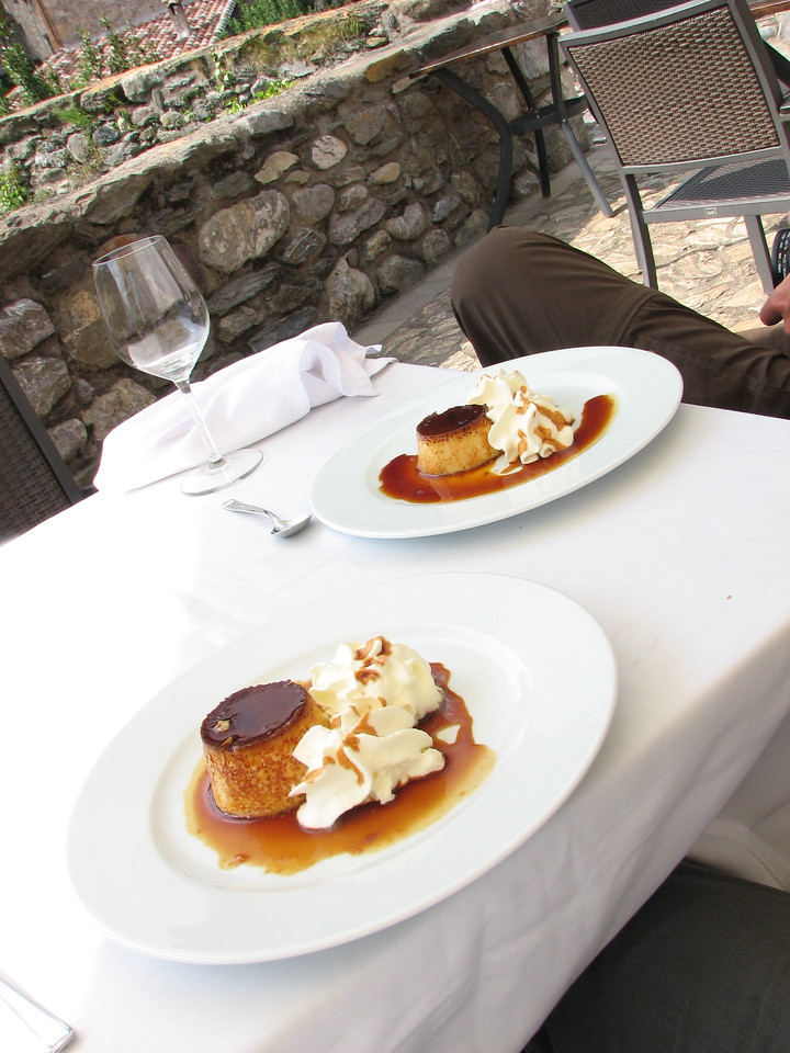 Fine dining for only a few euros in the little town square in Plaça de Beget, Alta Garrotxa, Catalonia, Spain. Pictured here is a favorite regional dessert, Creme de Catalana.
