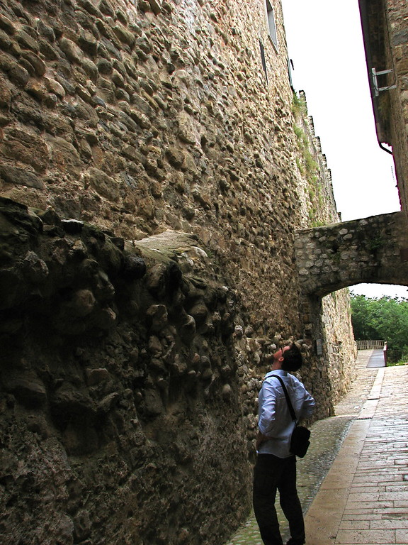 Yup; there's a lot of rocks in that wall. Old street in the medieval town of Besalu, Catalonia, Spain
