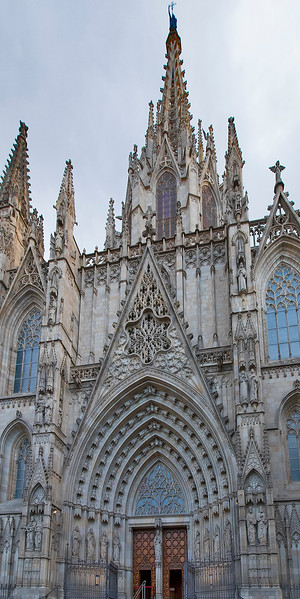 Nineteenth century Neo-Gothic facade of the 14th-century Barcelona Cathedral.  It is dedicated to the Holy Cross, and the teen-age martyr Saint Eulalia.