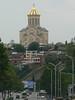 View of Tsminda Sameba on the left bank of the Mtkvari river from a right bank city street