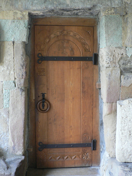 Modern door in an old wall at Antioki