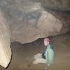 Larry sliding beneath a rock overhang.