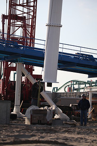 November 28, 2012: A steel support column is lowered onto the concrete footer at the GateKeeper construction site.