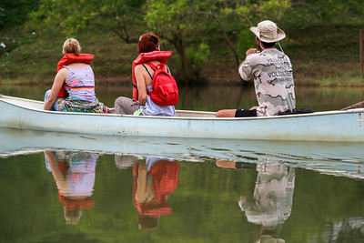 Canoeing in the Mopan River of Belize