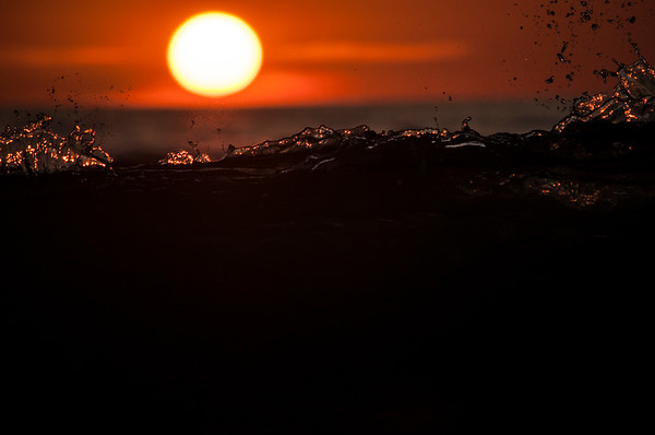 Wave at sunset