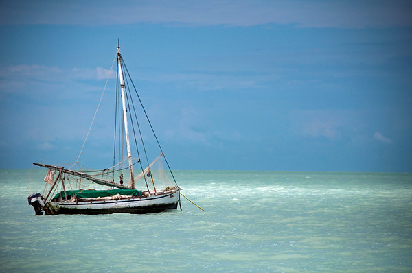 Sailboat moored in the silty waters of the Caribbean