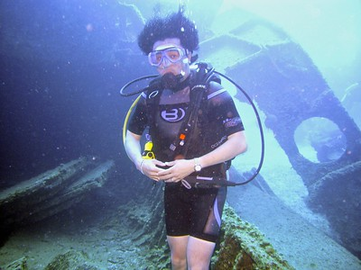 Syndrome (Buddy) from the Incredibles goes diving (Note the large B on his costume)