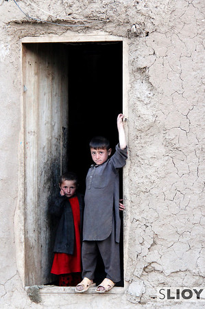 In all honesty, this is probably my favorite photo from the whole Afghan trip. While most of the village kids played ball up the hill, these two just stood looking longingly out their front door.