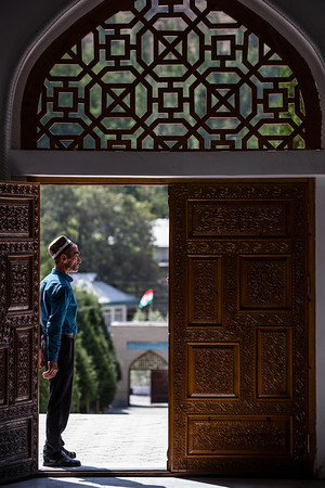 A local docent stands just outside the entrance of the Rudaki Mausoleum in the Fann Mountains of Tajikistan.