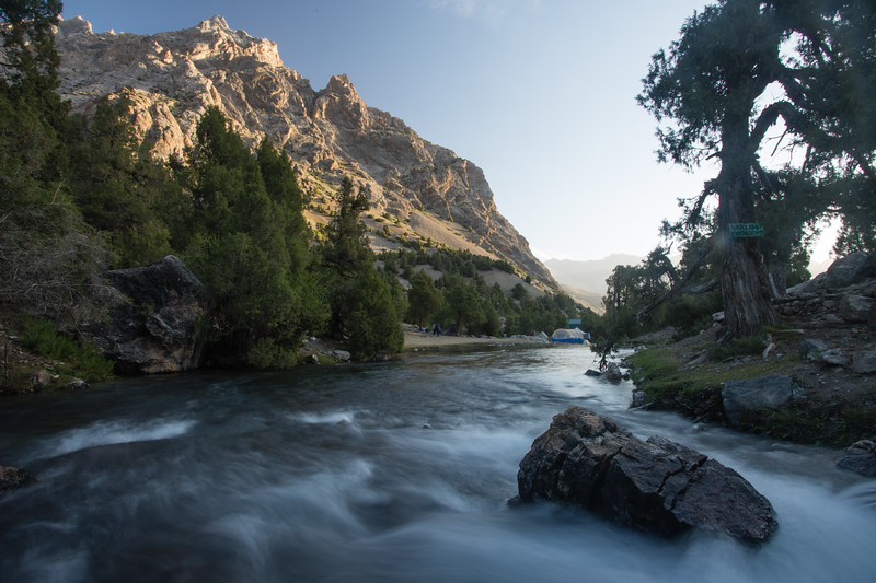 Sunrise over the small stream that drains from Alauddin Lake in the Fann Mountains of Tajikistan.