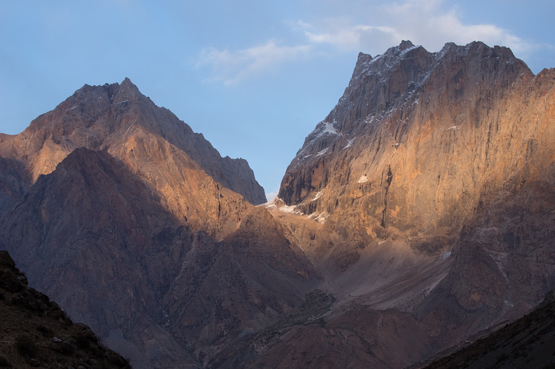 Sun lights up the mountains of the Yagnob Valley in Tajikistan.