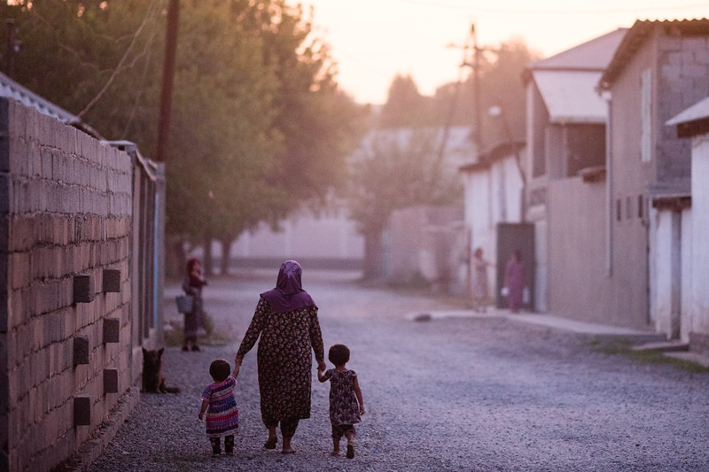 A local family out for a stroll at sunset in the village of Hisor near Dushanbe, Tajikistan.