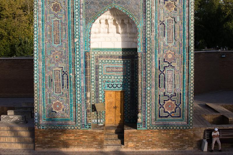 A local boy walking through the Shah-i-Zinda Mausoleum complex in Samarkand, Uzbekistan.