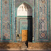 A local boy walking through the Shah-i-Zinda Mausoleum complex in Samarkand, Uzbekistan.