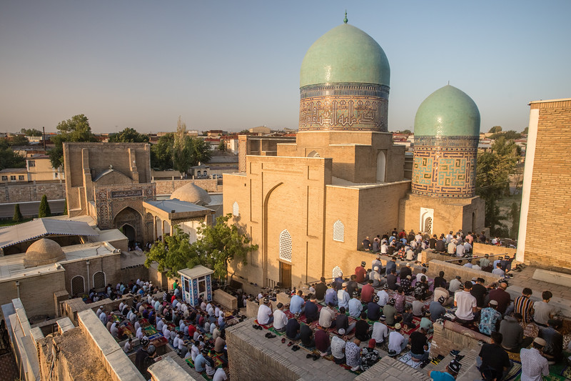 Locals gather for prayer on Kurban Eid outside a mosque below the Shah-i-Zinda Mausoleum complex in Samarkand, Uzbekistan.