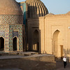 A local man walking through the Shah-i-Zinda Mausoleum complex in Samarkand, Uzbekistan.