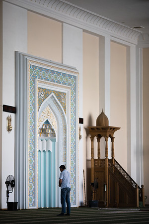 A local believer in prayer at the Juma Mosque in Tashkent, Uzbekistan.