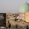 A local woman cleans a headstone on Kurban Eid in the cemetery behind the Shah-i-Zinda Mausoleum complex in Samarkand, Uzbekistan.