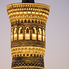 Bukhara's Kalon Minaret lights up as the sun sets over the city.
